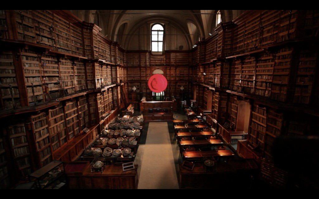 Frame grab from the actual promo footage showing the entire view of the Biblioteca Angelica with the art works installed.